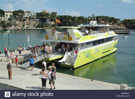 Catamaran Boat Trip Mallorca by Catamaran Boat Trip And Passengers On The Quay Porto