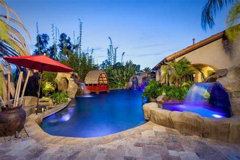 tropical poolscape  lumbung cabana  stone