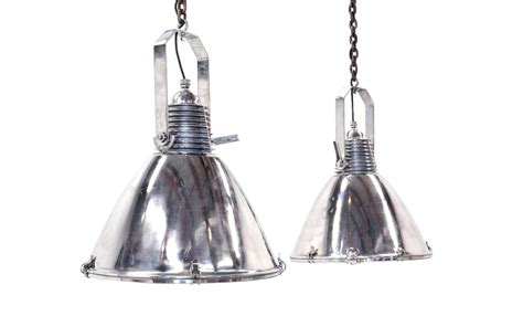 pair of large stainless steel marine light fixtures or