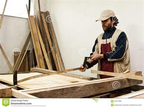 carpenter making furniture stock image image  carpenter