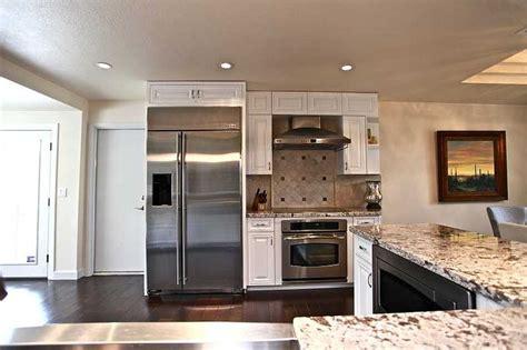 stainless steel appliances granite countertops white