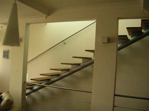 indoor steps mesmerizing grey iron column for stright style modern stairs with wooden foot steps as well as