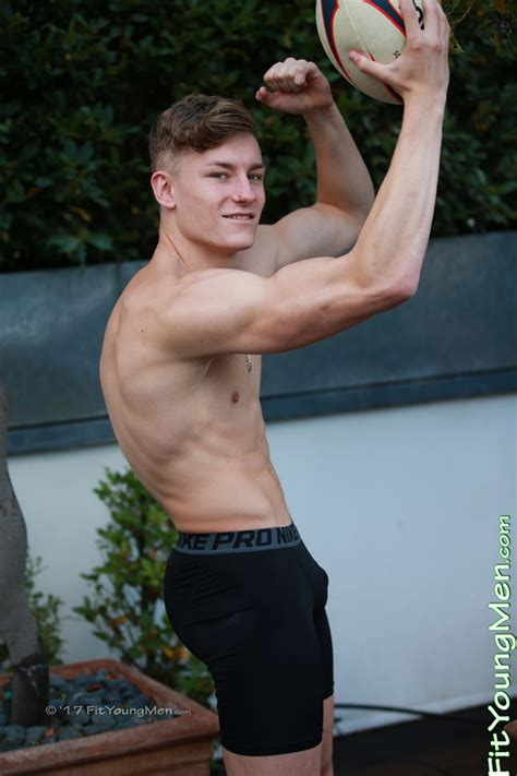 Fit Young Men Model Martin Aspey Rugby Player Young Rugby Stud Martin Pumps His Muscles Hard