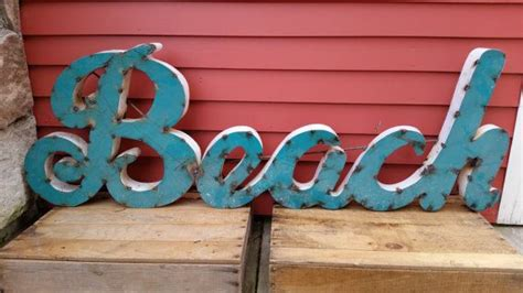 metal word beach  cursive rustic recessed industrial rusty rusted vintage  letters