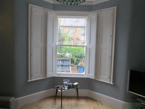 solid traditional window shutters  aspiration blinds