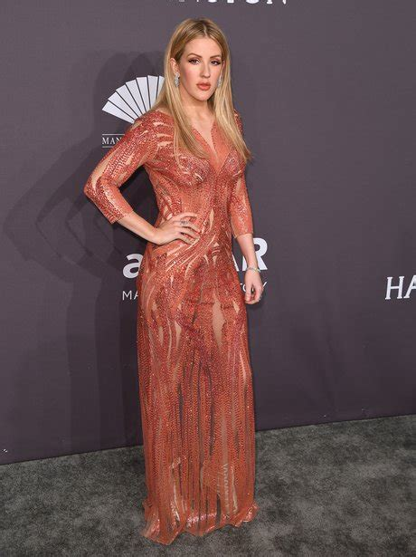 Ellie Goulding matches her lipstick to her orange gown at ...