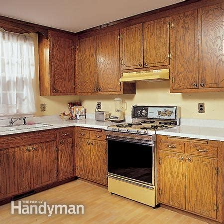 how to redo kitchen cabinets yourself how to refinish kitchen cabinets the family handyman