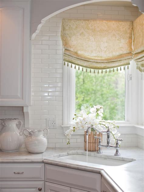 A corner sink takes center stage in this white traditional