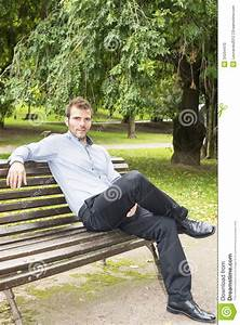 Man Sitting And Relaxing On A Bench. Stock Photo - Image ...