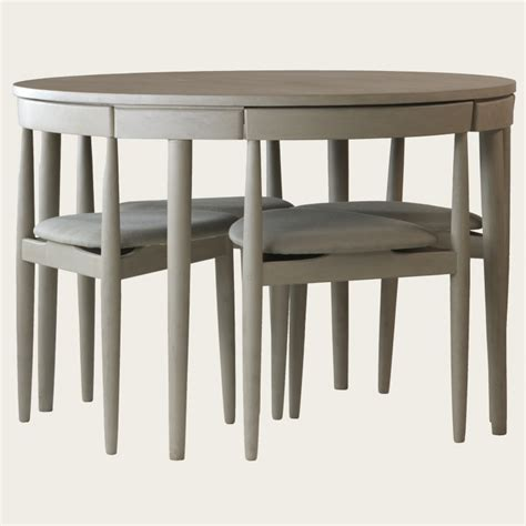 table with four chairs three legs furniture mid