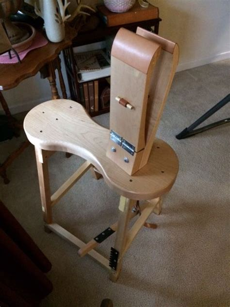 harness maker stitching horse leather working leather