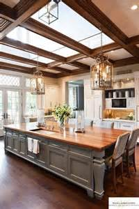 Large Kitchen Designs With Islands This Large Kitchen Has An Island That Doubles As A Table And Sky Lights Above To Bring In The