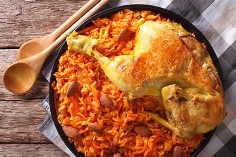 arabic food kabsa chicken  rice  vegetables close