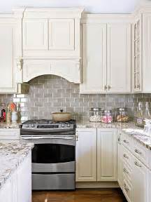 backsplash subway tiles for kitchen smoke gray glass subway tile backsplash white shaker cabinets neutral quartz countertop