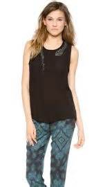WornOnTV: Aria's black top with embellished snake on ...