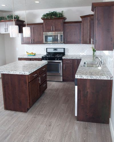 Since floors and walls are two of a room's biggest surfaces, the color of each ought to supplement the other. kitchens with light cherry cabinets and wood floors ...