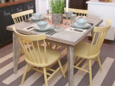 pale yellow painted wooden kitchen chairs and distressed