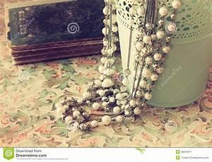 Vintage Pearl Necklace Over Floral Pattern Background ...