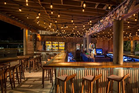 Big Home Bar by Tiki Bar At The Postcard Inn Bigtime Design Studios