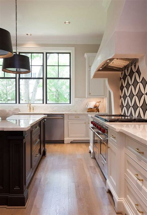 white kitchen  dark island cement tile backsplash