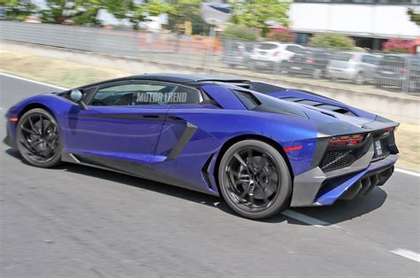 lamborghini aventador sv roadster roof spied lamborghini aventador sv roadster exposes its removable roof photo gallery motor trend
