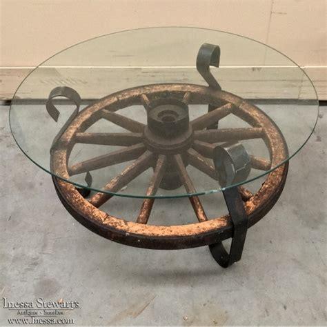 wagon wheel coffee table 19th century wagon wheel coffee table inessa stewart 39 s