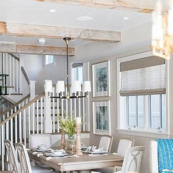 gray wash wood ceiling beams  limestone fireplace