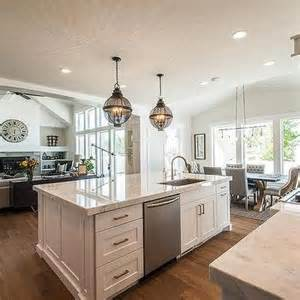 kitchen island with sink and dishwasher and seating backless gray tufted counter stools with silver nailhead trim transitional kitchen