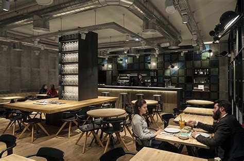 Kitchen Floor Tiles Ideas - industrial style and reclaimed materials at the ohbo organic café in barcelona designed by