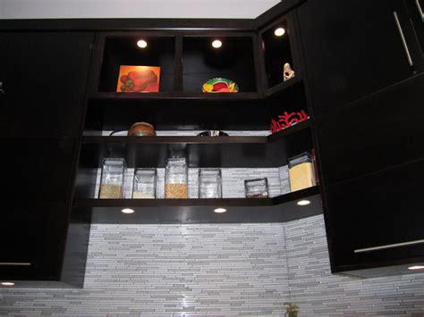 Modern Above Kitchen Cabinet Decor by Recessed Led Puck Lights Also Used For The Alcoves Above