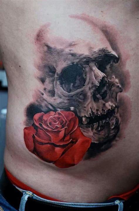 skull  rose tattoo skull art pinterest skull rose tattoos skulls  tattoos  body art