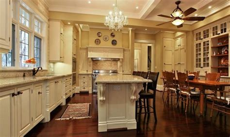 kitchen island with corbels white kitchen island with carved wood corbels under countertop and a small oriental rug