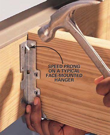 install joist hangers diy deck building  deck deck design