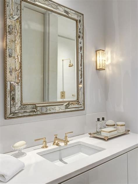 gold bathroom mirror white and gold bathroom features an antiqued mirror 12985