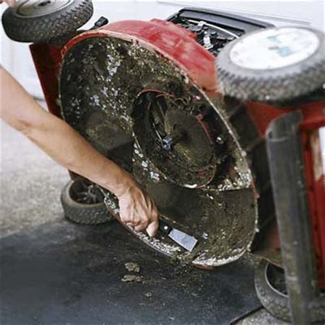 how to clean lawn mower clean the undercarriage how to store your lawn mower for the cold season this old house