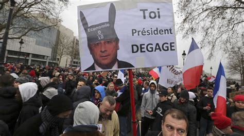 day  anger thousands rally  paris  protest hollande