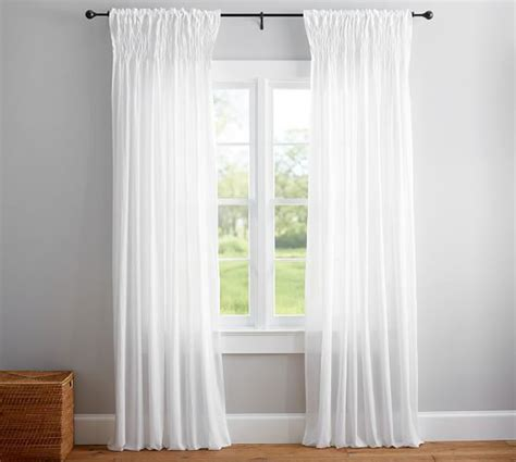 Organic Cotton Drapes - organic cotton smocked voile curtain paired with a clear