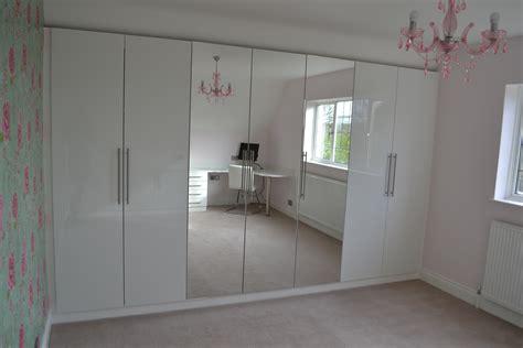 stylish bedroom  gloss white cabinet  custom