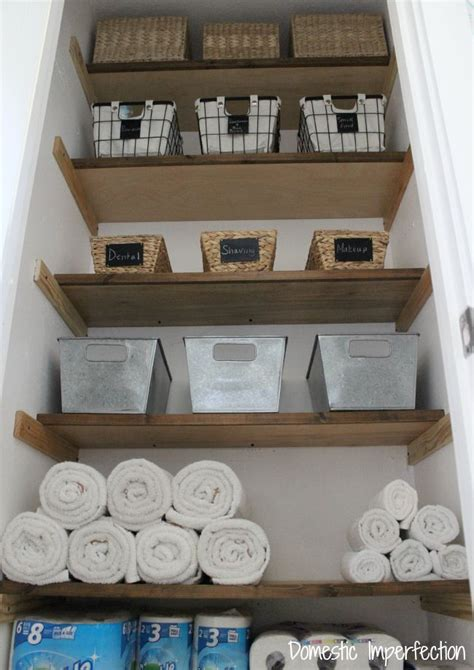 linen closet organization and the end of my pink walls