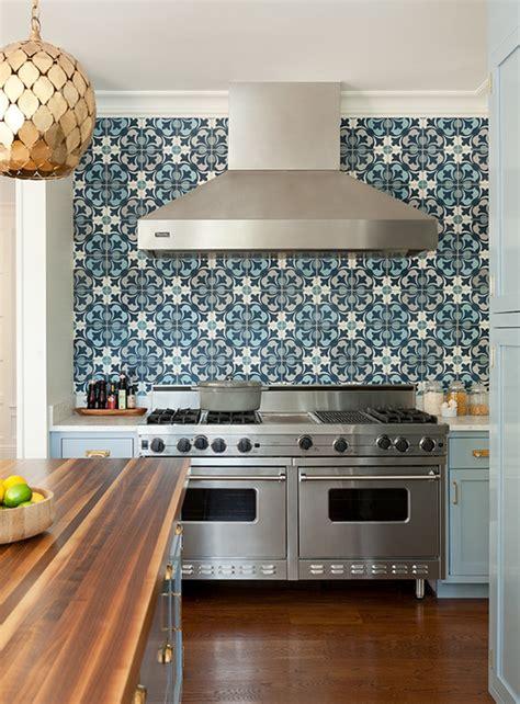 granite topped kitchen island blue kitchen cabinets with blue mosaic tile backsplash