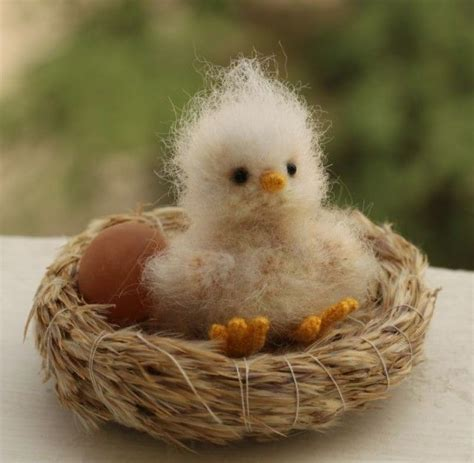 baby birds a very fuzzy baby bird in a little straw nest would look sweet on your table as a place name