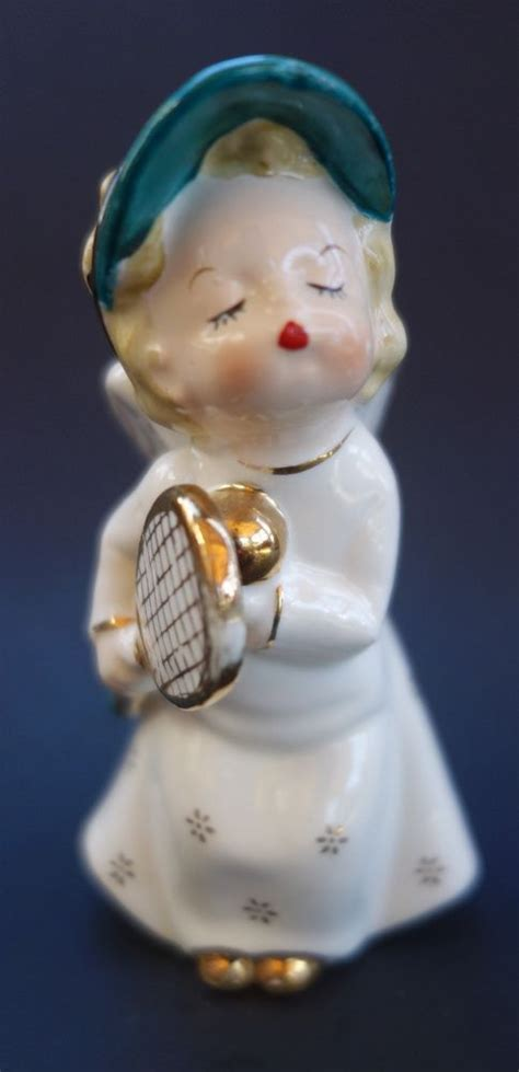 vintage angel figurine  tennis racket ball ceramic   fine quality japan tennis tennis