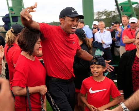 Tiger Woods Caddies For 10-Year-Old Son At Junior Golf Event