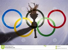 Silhouette Of Sport Torch Behind Olympic Flag Editorial