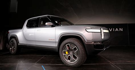 amazon invests  rivian  tesla rival  electric