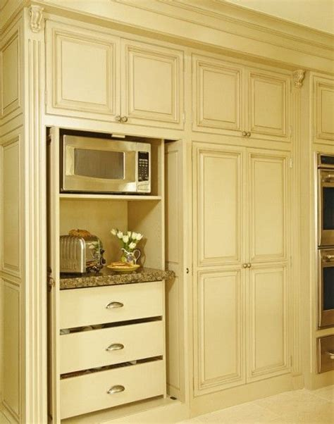 Pocket Door Kitchen Cabinets by Appliance Storage Built Into Cabinet With Pocket