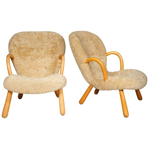 clam chair fishing seat pair of clam chairs by philip arctander at 1stdibs