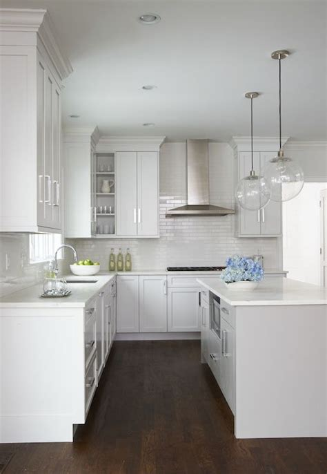 beautiful kitchen features  pair  clear glass globe