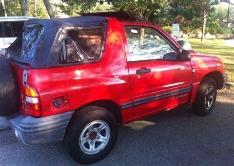 sell   chevrolet tracker  door red great deal
