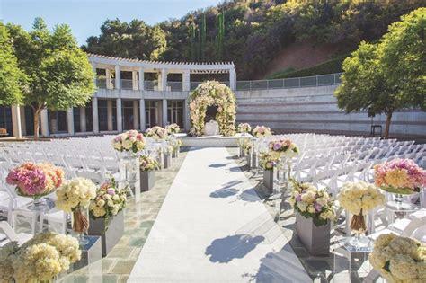 outdoor jewish ceremony elegant reception with purple